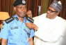 President Buhari Decorates New Inspector General of Police