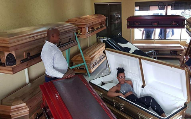 Pantless dancer buys her coffin ahead of her death (photos)